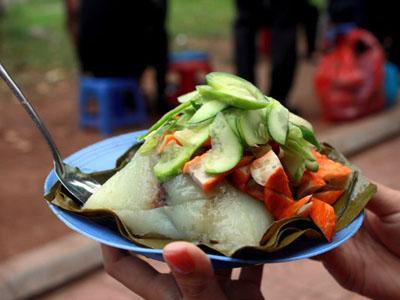 Pyramidal rice dumpling with sausages in Vietnam